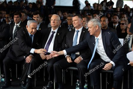 Israeli Blue and White party chief Benny Gantz (R) reaches out to shake hands with Israeli Prime Minister Benjamin Netanyahu (L), during a state memorial ceremony for Yitzhak and Leah Rabin, at Mt. Herzl in Jerusalem, 10 November 2019. Yitzhak Rabin was shot dead on 04 November 1995 just two years after the signing of the Oslo peace accords, for which he and former Israeli president Shimon Peres were awarded the Nobel Peace Prize along with late veteran Palestinian leader Yasser Arafat.