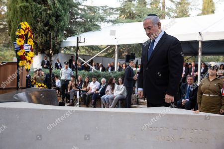 Israeli Prime Minister Benjamin Netanyahu stands before the grave of the late Yitzhak Rabin, during a state memorial ceremony for Yitzhak and Leah Rabin, at Mt. Herzl in Jerusalem, 10 November 2019. Yitzhak Rabin was shot dead on 04 November 1995 just two years after the signing of the Oslo peace accords, for which he and former Israeli president Shimon Peres were awarded the Nobel Peace Prize along with late veteran Palestinian leader Yasser Arafat.