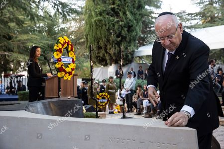 Israeli President Reuven Rivlin lays a stone on the grave of the late Prime Minister Yitzhak Rabin during a state memorial ceremony for Yitzhak and Leah Rabin, at Mt. Herzl in Jerusalem, 10 November 2019. Yitzhak Rabin was shot dead on 04 November 1995 just two years after the signing of the Oslo peace accords, for which he and former Israeli president Shimon Peres were awarded the Nobel Peace Prize along with late veteran Palestinian leader Yasser Arafat.