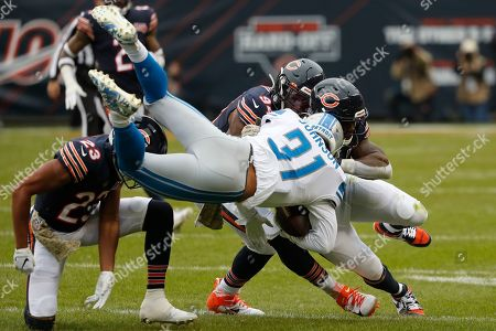 Detroit Lions running back Ty Johnson (31) is brought down by Chicago Bears cornerback Kyle Fuller (23), linebacker Danny Trevathan (59) and Leonard Floyd (94) during the first half of an NFL football game in Chicago