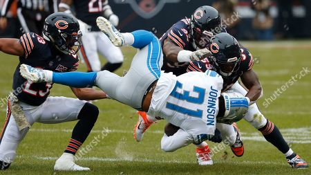 Stock Photo of Detroit Lions running back Ty Johnson (31) is brought down by Chicago Bears cornerback Kyle Fuller (23), linebacker Danny Trevathan (59) and Leonard Floyd (94) during the first half of an NFL football game in Chicago