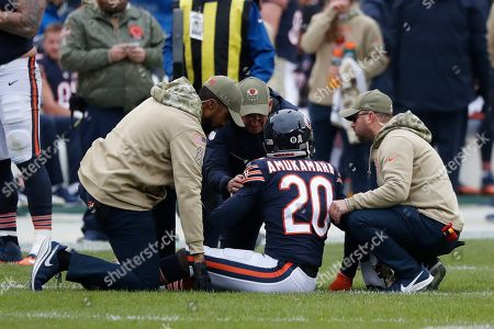 Chicago Bears cornerback Prince Amukamara (20) is attended to by medical staff during the first half of an NFL football game against the Detroit Lions in Chicago