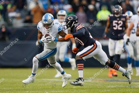 Detroit Lions wide receiver Marvin Jones (11) runs after a catch as Chicago Bears cornerback Prince Amukamara (20) defends during the second half of an NFL football game in Chicago