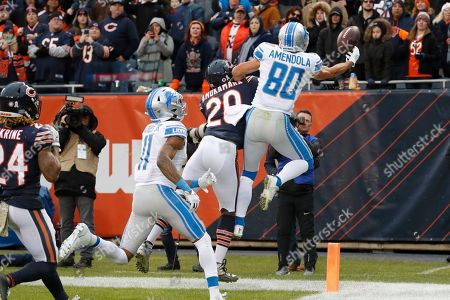 Detroit Lions wide receiver Danny Amendola (80) watches a pass off his fingers as Chicago Bears cornerback Prince Amukamara (20) defends in the end zone during the second half of an NFL football game in Chicago