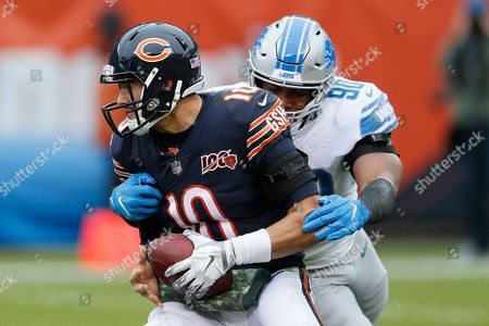 Detroit Lions defensive end Trey Flowers (90) wraps up Chicago Bears quarterback Mitchell Trubisky (10) during the first half of an NFL football game in Chicago