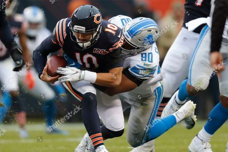 Detroit Lions defensive end Trey Flowers (90) sacks Chicago Bears quarterback Mitchell Trubisky (10) during the second half of an NFL football game in Chicago