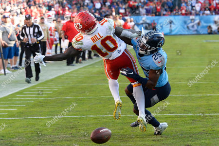 Tennessee Titans cornerback Adoree' Jackson (25) breaks up a pass intended for Kansas City Chiefs wide receiver Tyreek Hill (10) in the second half of an NFL football game, in Nashville, Tenn