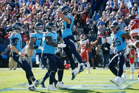 Tennessee Titans tight end Anthony Firkser (86) celebrates with offensive guard Rodger Saffold (76) after Firkser scored a touchdown against the Kansas City Chiefs in the first half of an NFL football game, in Nashville, Tenn