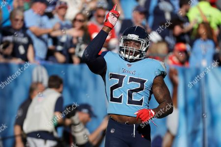 Tennessee Titans running back Derrick Henry celebrates after scoring a touchdown on a 68-yard run against the Kansas City Chiefs in the second half of an NFL football game, in Nashville, Tenn