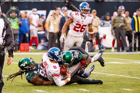 , 2019, New York Jets nose tackle Steve McLendon (99) and outside linebacker James Burgess (58) sack New York Giants quarterback Daniel Jones (8) during the NFL game between the New York Giants and the New York Jets at MetLife Stadium in East Rutherford, New Jersey