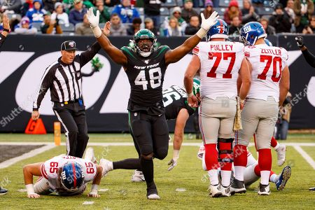 , 2019, New York Jets outside linebacker Jordan Jenkins (48) reacts to his sack on New York Giants quarterback Daniel Jones (8) during the NFL game between the New York Giants and the New York Jets at MetLife Stadium in East Rutherford, New Jersey