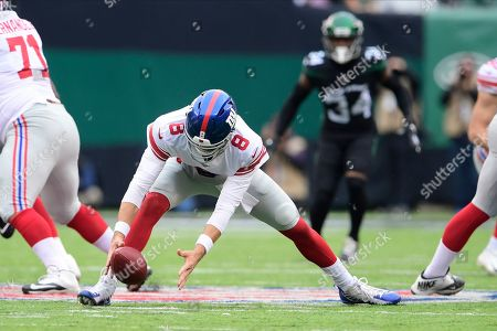 New York Giants quarterback Daniel Jones (8) loses control of the ball during the first half of an NFL football game against the New York Jets, in East Rutherford, N.J