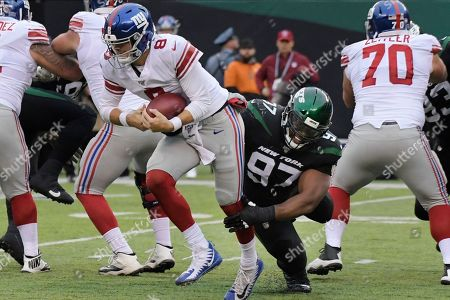New York Jets' Nathan Shepherd (97) sacks New York Giants quarterback Daniel Jones (8) during the second half of an NFL football game, in East Rutherford, N.J
