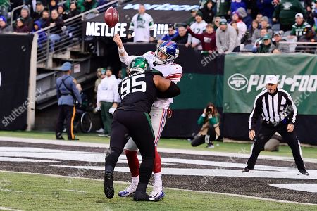 Stock Image of New York Jets' Quinnen Williams (95) hits New York Giants quarterback Daniel Jones (8) during the second half of an NFL football game, in East Rutherford, N.J. The Jets won 34-27