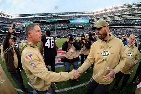 New York Giants head coach Pat Shurmur, left, shakes hands with New York Jets head coach Adam Gase after an NFL football game, in East Rutherford, N.J. The Jets won 34-27