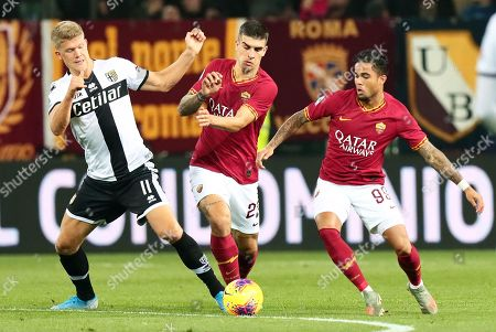 Parma's Andreas Cornelius (L) in action against Roma players Gianluca Mancini (C) and Justin Kluivert (R) during the Italian Serie A soccer match between Parma Calcio and AS Roma at Ennio Tardini stadium in Parma, Italy, 10 November 2019.