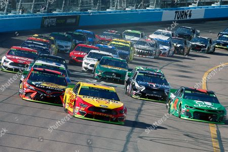 Joey Logano (22) leads the field through Turn 4 during a NASCAR Cup Series auto race at ISM Raceway, in Avondale, Ariz