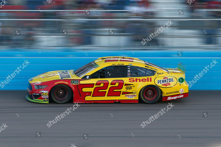Joey Logano drives into Turn 4 during a NASCAR Cup Series auto race at ISM Raceway, in Avondale, Ariz