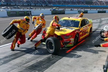 Joey Logano makes a pit stop during the NASCAR Cup Series auto race, in Avondale, Ariz