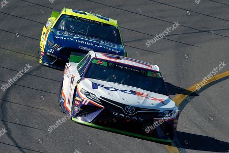Denny Hamlin (11) drives through Turn 4 in front of Paul Menard during a NASCAR Cup Series auto race at ISM Raceway, in Avondale, Ariz