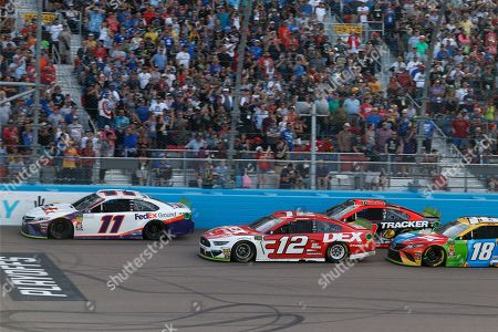Denny Hamlin (11) leads Ryan Blaney (12), Martin Truex Jr. (19) and Kyle Busch (18) on a restart with three laps to go during a NASCAR Cup Series auto race at ISM Raceway, in Avondale, Ariz. Hamlin went on to win the race