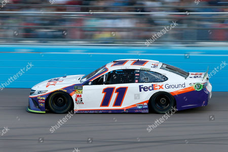 Denny Hamlin drives through Turn 4 during a NASCAR Cup Series auto race at ISM Raceway, in Avondale, Ariz. Hamlin went on to win the race