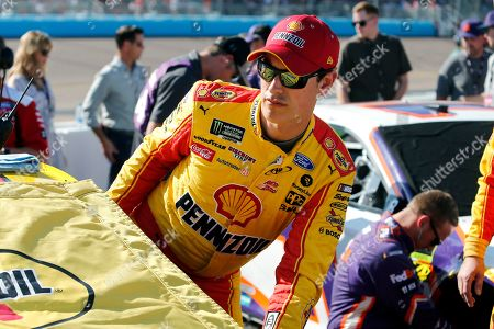 Joey Logano climbs into his race car prior to a NASCAR Cup Series auto race at ISM Raceway, in Avondale, Ariz