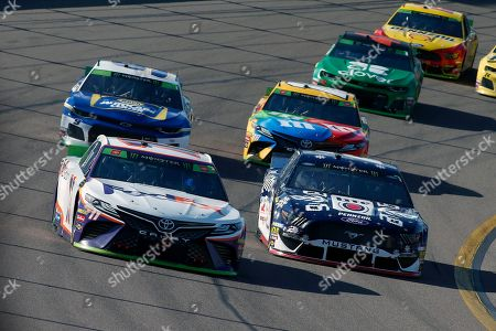 Denny Hamlin (11) drives out of Turn 4 ahead of Brad Keselowski (2), Chase Elliott (9) and Kyle Busch (18) during a NASCAR Cup Series auto race at ISM Raceway, in Avondale, Ariz
