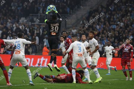 ONE. Marseille's goalkeeper Steve Mandanda catches the ball during the French League One soccer match between Marseille and Lyon at the Velodrome stadium in Marseille, southern France