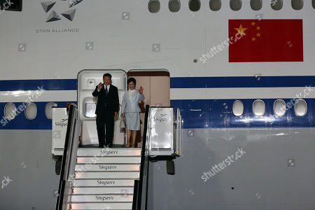 Chinese President Xi Jinpin (L) and his wife Peng Liyuan (R) get off the plane on arrival in Athens, Greece, 10 November 2019. The Chinese President is coming to Greece for a two-day official visit.