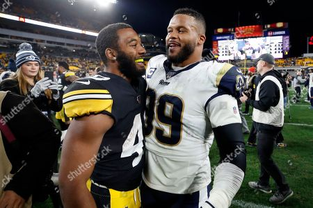 Pittsburgh Steelers running back Tony Brooks-James, left, and Los Angeles Rams defensive tackle Aaron Donald (99) visit on the field following an NFL football game in Pittsburgh, . The Steelers won 17-12