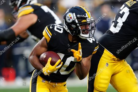Pittsburgh Steelers running back Tony Brooks-James (40) carries the football during the first half of an NFL football game against the Los Angeles Rams in Pittsburgh