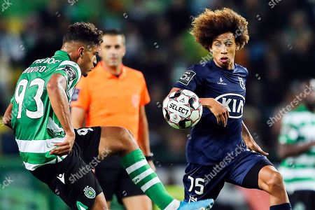 Rodrigo (L) of Sporting in action against Robinho (R) of Belenenses during the Portuguese First League soccer match between Sporting Lisbon and Belenenses Lisbon at Alvalade Stadium in Lisbon, Portugal, 10 November 2019.