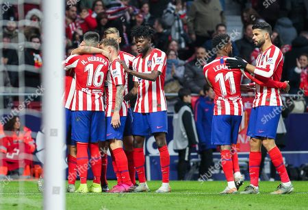 Hector Herrera, player of Atletico Madrid from Mexico, Kieran Trippier, player of Atletico Madrid from England, Koke Resurreccion, player of Atletico Madrid from Spain, Thomas Partey, player of Atletico Madrid from Ghana, Thomas Lemar, player of Atletico Madrid from France, and Diego Costa, player of Atletico Madrid from Spain, celebrates a goal