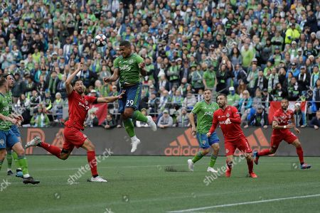 Seattle Sounders defender Roman Torres (29) leaps for a header against Toronto FC, during the first half of the MLS Cup championship soccer match in Seattle