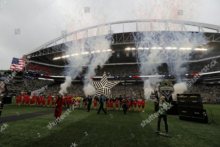 Stock Image of Mike McCready, right, guitarist for Pearl Jam, plays, before the MLS Cup championship soccer match against the Toronto FC in Seattle