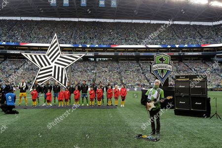 Mike McCready, guitarist for Pearl Jam, plays, before the MLS Cup championship soccer match against the Toronto FC in Seattle