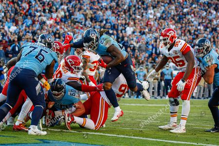 Stock Photo of Tennessee Titans running back Derrick Henry, 22, scores a touchdown against the Kansas City Chiefs in the second half of their NFL game at Nissan Stadium in Nashville, Tennessee, USA, 10 November 2019. The Titans won 35-32.