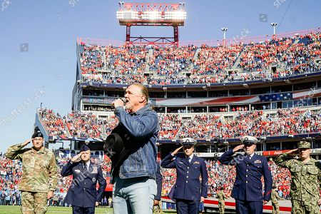 Country music singer Trace Adkins sings the national anthem before the Kansas City Chiefs at Tennessee Titans in their NFL game at Nissan Stadium in Nashville, Tennessee, USA, 10 November 2019. The team was celebrating veterans in advance of Veterans Day on 11 November. The pregame show featured members of the military and included a flyover by helicopters from Ft. Campbell near Nashville. The Titans won 35-32.