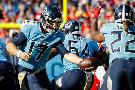 Tennessee Titans quarterback Ryan Tannehill, 17, left, hands the ball off to Tennessee Titans running back Derrick Henry, 22, against the Kansas City Chiefs in the second half of their NFL game at Nissan Stadium in Nashville, Tennessee, USA, 10 November 2019. The Titans won 35-32.