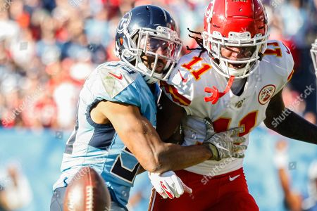Tennessee Titans inside linebacker Wesley Woodyard, 59, breaks up a pass intended for Kansas City Chiefs wide receiver Demarcus Robinson, 11, in the second half of their NFL game at Nissan Stadium in Nashville, Tennessee, USA, 10 November 2019. The Titans won 35-32.