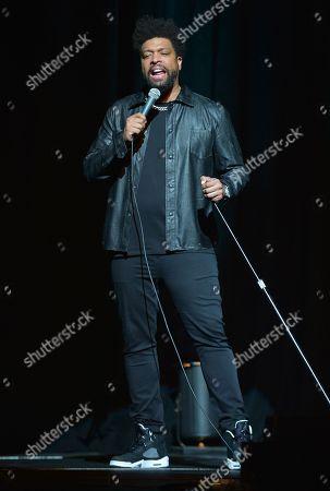 DeRay Davis performs on stage
