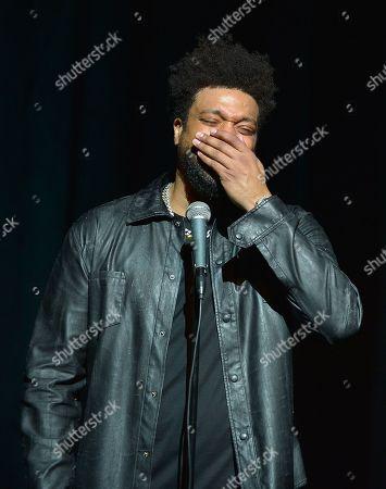 Stock Photo of DeRay Davis performs on stage