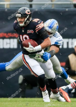 Chicago Bears quarterback Mitchell Trubisky (L) escapes the grasp of Detroit Lions defensive end Trey Flowers (R) during the NFL game between the Detroit Lions and the Chicago Bears at Soldier Field in Chicago, Illinois, USA, 10 November 2019.