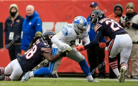 Detroit Lions running back Ty Johnson (C) is tackled by Chicago Bears inside linebacker Roquan Smith  (L) and Chicago Bears cornerback Prince Amukamara (R) during the NFL game between the Detroit Lions and the Chicago Bears at Soldier Field in Chicago, Illinois, USA, 10 November 2019.