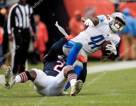 Detroit Lions running back J.D. McKissic (R) is tackled by Chicago Bears cornerback Prince Amukamara (L) during the NFL game between the Detroit Lions and the Chicago Bears at Soldier Field in Chicago, Illinois, USA, 10 November 2019. The Bears won the game.