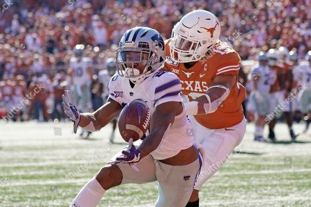 Stock Picture of Kansas State's Wykeen Gill (21) reaches for a touchdown catch as Texas' Brandon Jones (19) defends during the first half of an NCAA college football game in Austin, Texas