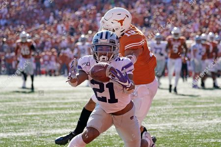 Kansas State's Wykeen Gill (21) reaches for a touchdown catch as Texas' Brandon Jones (19) defends during the first half of an NCAA college football game in Austin, Texas
