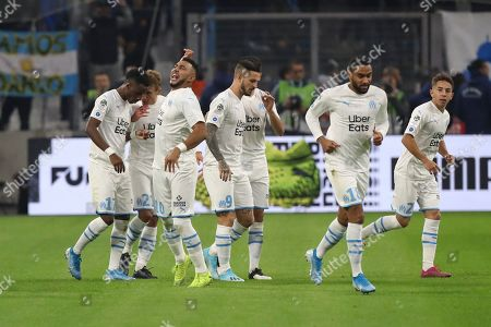 ONE. Marseille's Dimitri Payet celebrates with his team after scoring a penalty during the French League One soccer match between Marseille and Lyon at the Velodrome stadium in Marseille, southern France