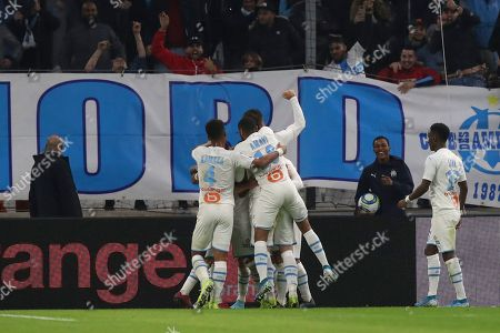 ONE. Marseille's Dimitri Payet celebrates with teammates after scoring his side's second goal during the French League One soccer match between Marseille and Lyon at the Velodrome stadium in Marseille, southern France